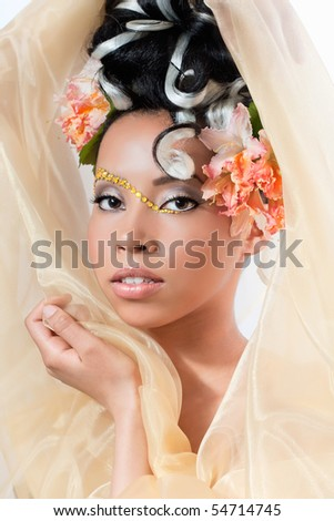 Portrait of a beautiful young girl with curly hairstyle and fantasy makeup - stock photo
