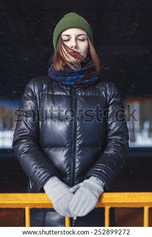 portrait of a beautiful young girl with eyes closed outdoors
