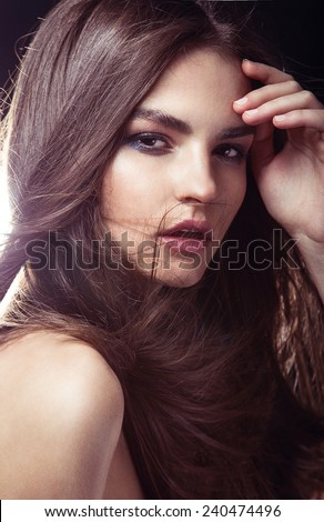 portrait of a beautiful young girl with tanned skin, radiant and velvety, with dark hair in a ponytail, elegant curves