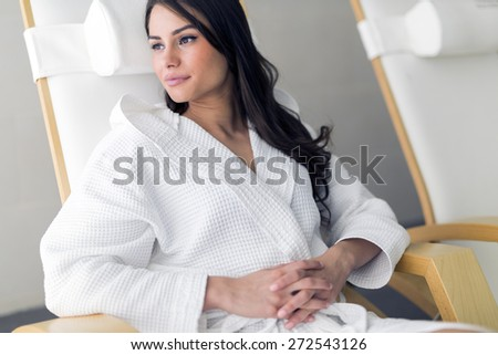 Portrait of a beautiful young  healthy woman relaxing in a robe - stock photo