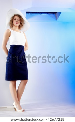 Portrait of a beautiful young lady in blue  apartment