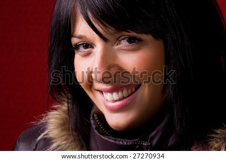 Portrait of a beautiful young lady smiling a toothy smile