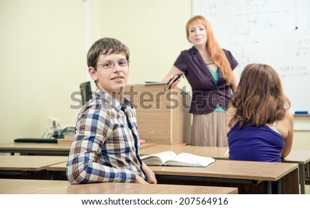 Portrait of a beautiful young student in the classroom