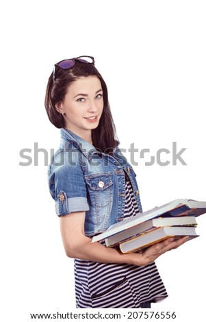 Portrait of a beautiful young student in the classroom - stock photo