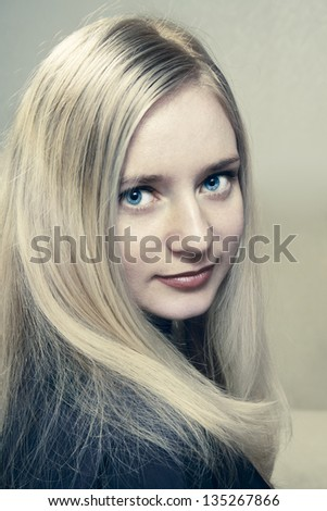portrait of a beautiful young woman close-up - stock photo