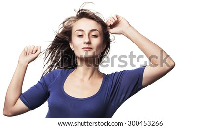 Portrait of a beautiful young woman dancing with hair flying. Isolated on white with copy-space. High-contrast image with intentional color shift