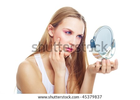 portrait of a beautiful young woman having skin problems - stock photo