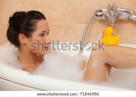 Portrait of a beautiful young woman in a bathroom. Concept body care. - stock photo