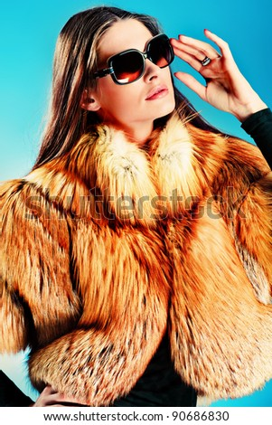 Portrait of a beautiful young woman in a fur. - stock photo