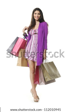portrait of a beautiful young woman, in a  holding in her hands a few shopping bags