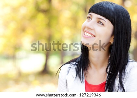 portrait of a beautiful young woman in autumn forest