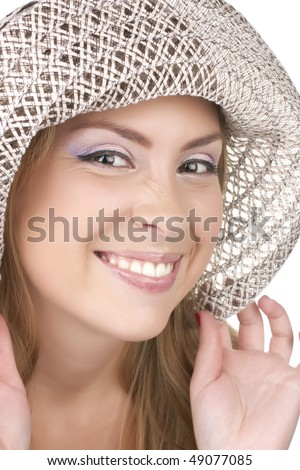 Portrait of a beautiful young woman in summer hat