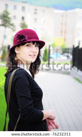 Portrait of a beautiful young woman in summer park. - stock photo