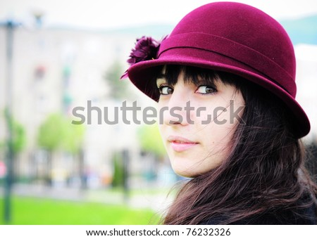 Portrait of a beautiful young woman in summer park.