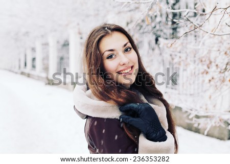 Portrait of a beautiful young woman in the winter.  - stock photo