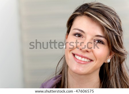 Portrait of a beautiful young woman indoors and smiling