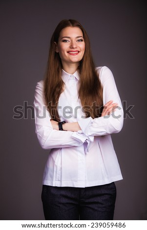 Portrait of a beautiful young woman, isolated on black background