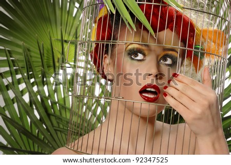 portrait of a beautiful young woman like parrots - stock photo
