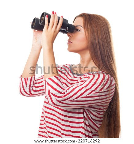portrait of a beautiful young woman looking through the binoculars