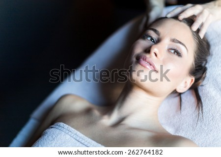 Portrait of a beautiful, young woman lying on a massage table - stock photo