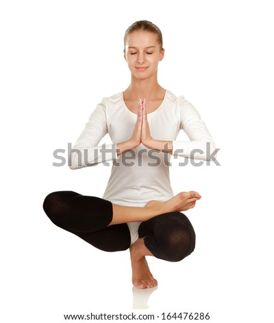 Portrait of a beautiful young woman meditating  isolated on white background - stock photo