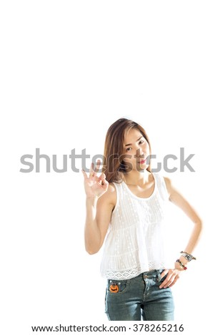Portrait of a beautiful young woman points a hand with positive facial expression, isolated on white background