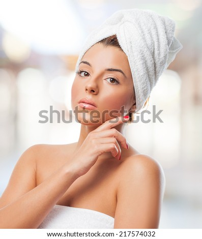 portrait of a beautiful young woman preparing to take a bath