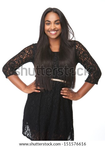 Portrait of a beautiful young woman smiling in black dress - stock photo
