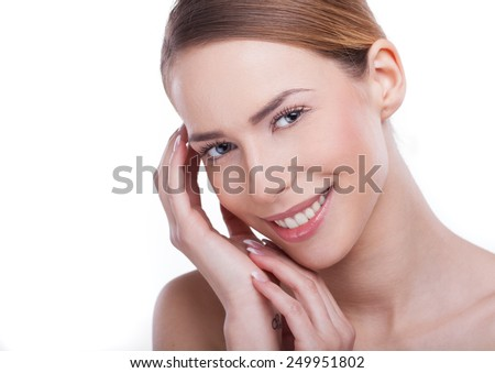 Portrait of a beautiful young woman smiling, with fingers on her face. Beauty concept  - stock photo