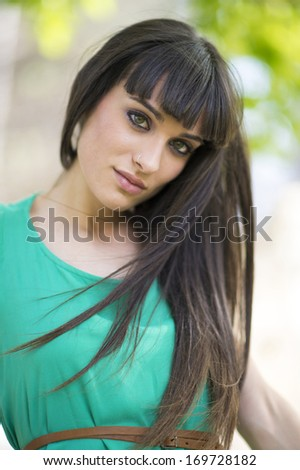 Portrait of a beautiful young woman staring at camera.