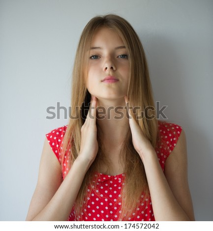 portrait of a beautiful young woman who hands hugging the neck