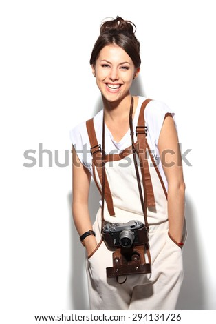 Portrait of a beautiful young woman with a camera
