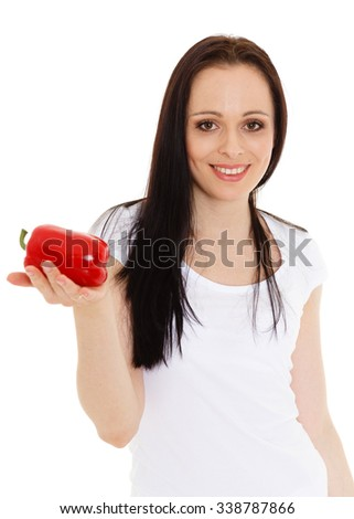 Portrait of a beautiful  young woman with a fresh red pepper on a white background. - stock photo