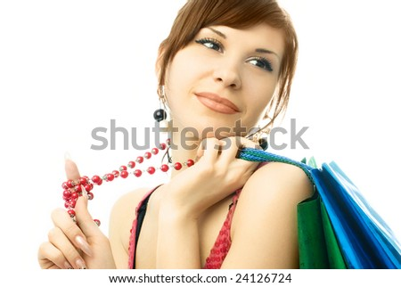 portrait of a beautiful young woman with a lot of shopping bags - stock photo