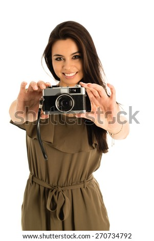 Portrait of a beautiful young woman with a photo camera, lifestyle image of an attractive Asian - Caucasian mixed woman - stock photo