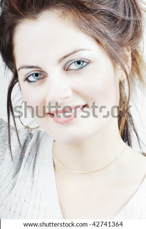 Portrait of a beautiful young woman  with blue eyes and long hair with selective focus - stock photo