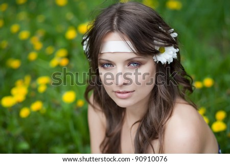 Portrait of a beautiful young woman with daisies in her hair, European, White, Caucasian - stock photo