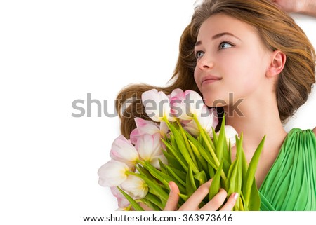 Portrait of a beautiful young woman with flowers - stock photo