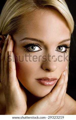 Portrait of a beautiful young woman with green eyes