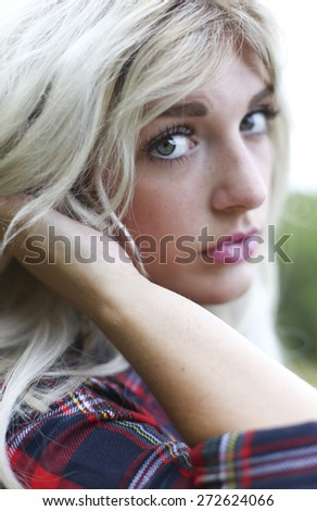 Portrait of a beautiful young woman with perfect skin and beautiful blue eyes - stock photo