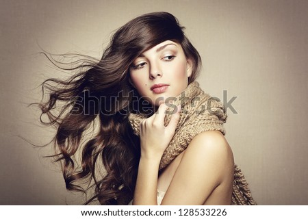 Portrait of a beautiful young woman with scarf. Fashion photo - stock photo