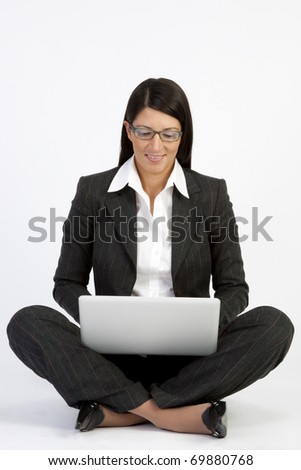 Portrait of a beautiful young woman working on laptop - stock photo