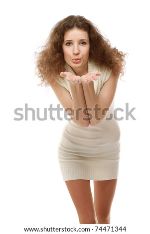 Portrait of a beautifull woman in a white dress on white