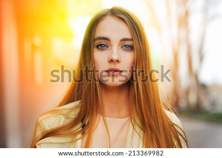 Portrait of a beauty blond woman at the sunny street - stock photo