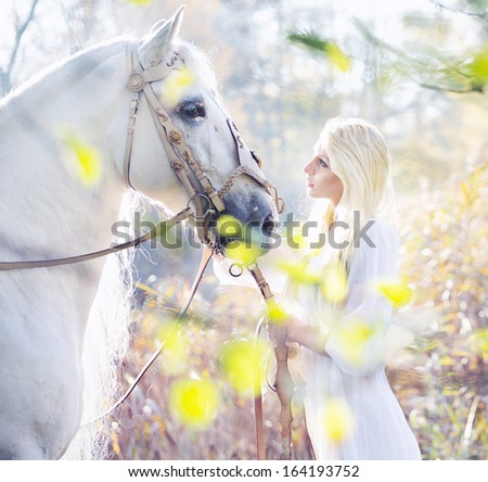Portrait of a beauty blondie with horse - stock photo
