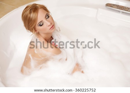 Portrait of a beauty young adult attractive sexy and sensuality pretty blonde woman in bath relaxing - stock photo