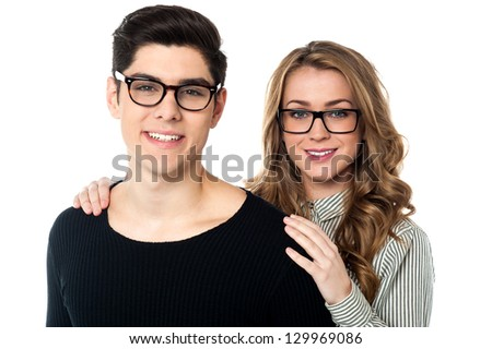 Portrait of a bespectacled young couple posing for a portrait. - stock photo