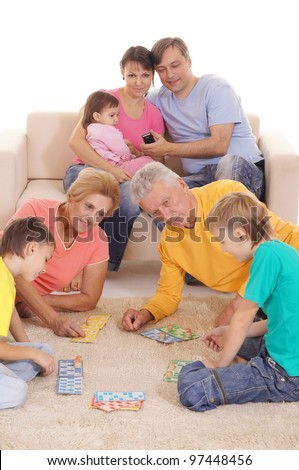 portrait of a big family playing on carpet - stock photo