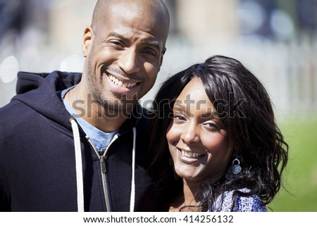 Portrait Of A Black Couple Smiling At The Camera At The Park
