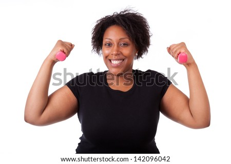 Portrait of a black fatty woman working out with free weights - African people ,isolated on white background - stock photo